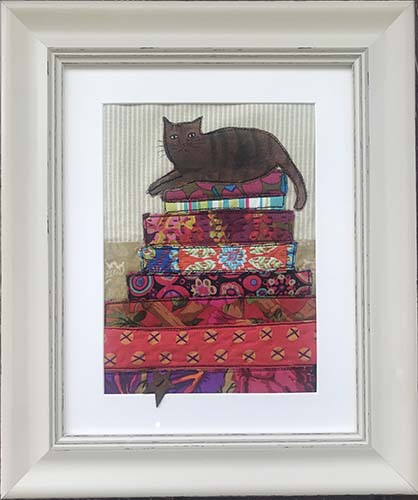 The cat sitting on the quilts. Textiles 28cm x 34cm